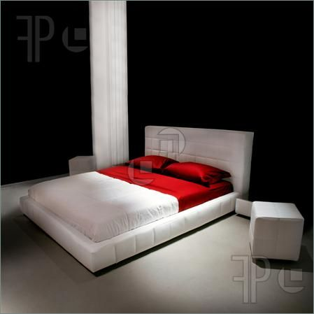 Double red and white bed in big bedroom