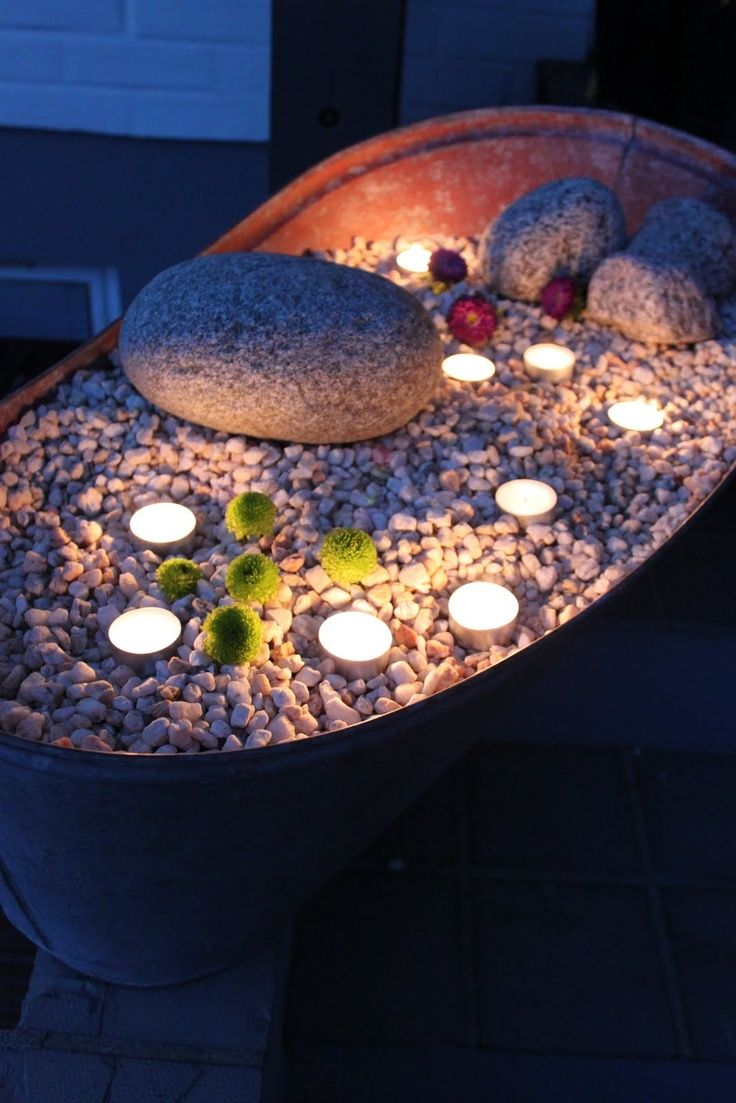 Love this little candle garden with stones. Would be great in any kind of old metal bucket or even a flower pot. Candle Impressions Flameless Tea Lights would be perfect for this