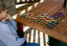 A boy with Asperger's playing with molecular structures.