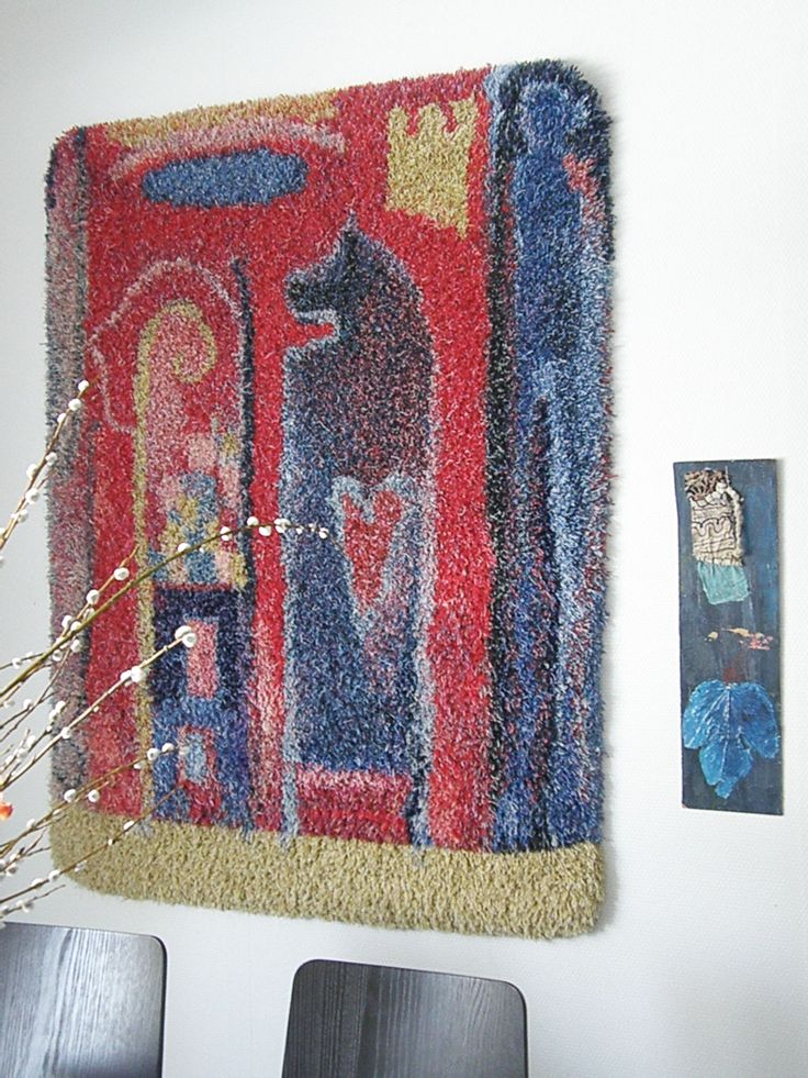 Rug  - Musta hevonen (Black Horse), wool, linen, 102cm x 146 cm, 2002. Design Annukka Mikkola, weaving Suvi Kankkonen.