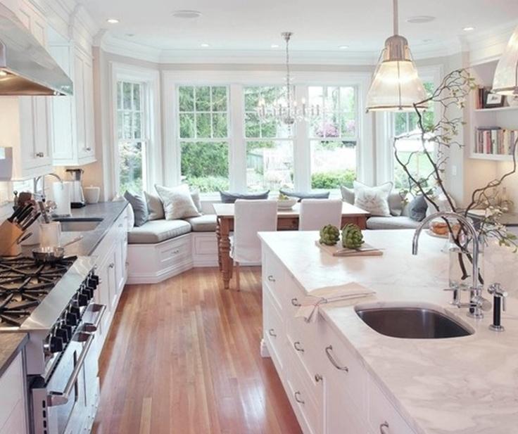 White kitchen, wood floor, marble sink counter, wide windows, corner sofa ⇒ :-)