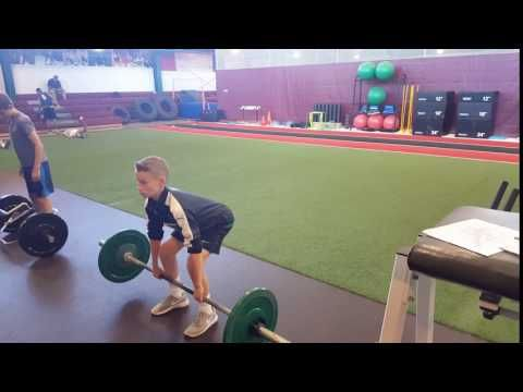TP1 Athletes, Matt and Nick, performing a straight bar dead lift; developing full body strength with this single exercise.  #Parisi #Speed #School at #HealthQuest in #Flemington #NJ