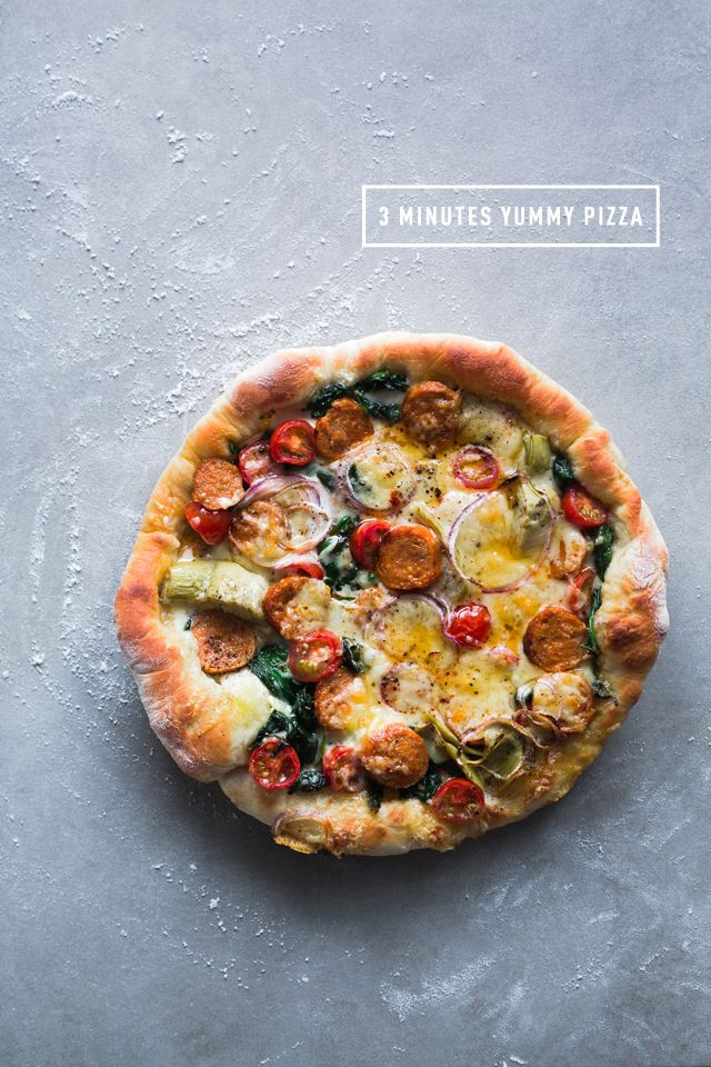 English recipe in finally up on the blog! Better late than never, yup! // 3 minutes cast iron skillet pizza on http://www.christelleisflabbergasting.com/en/2014/01/3-minutes-pizza-italian-sausage-spinach-cherry-tomatoes-artichoke-hearts-and-mozzarella-cheese.html