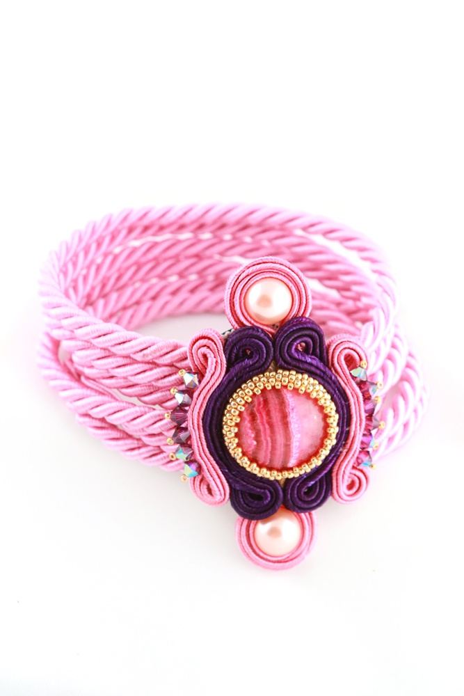 Rope bracelet with soutache embroidery on pink chalcedony cabochon.   The clasp are hidden on both sides of cabochon