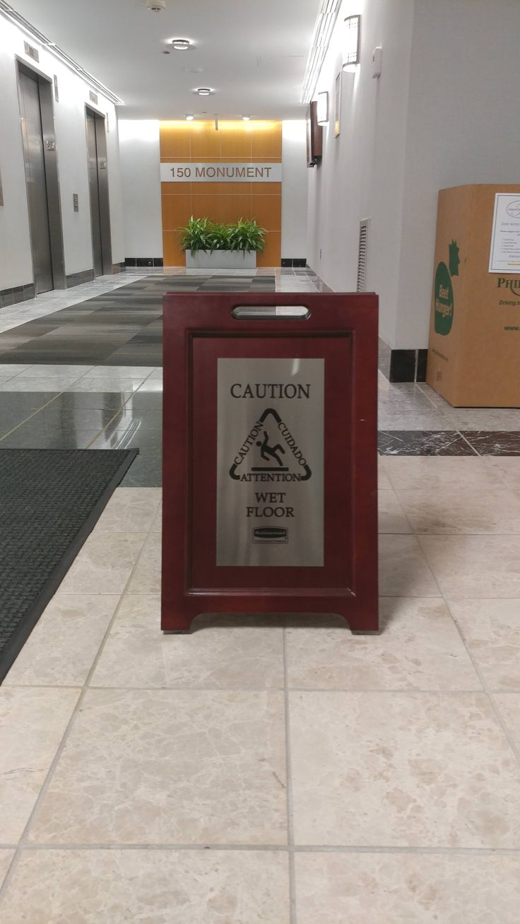 This wooden wet floor sign.