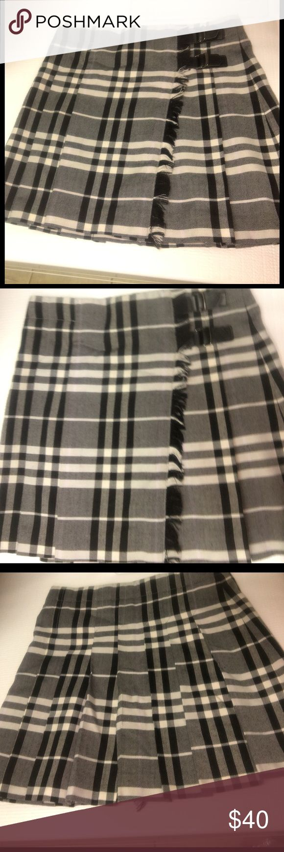Girls size 8 Burberry skirt Girls size 8 Burberry skirt gently worn Burberry Bottoms Skirts