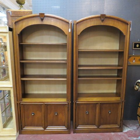 sold 295 each vintage mid century modern pair fruitwood book cases with doors c arched top three shelves two doors on bottom for storage with