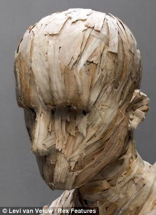 Weird sculpture art | ... strange shocking Dutch artist Levi van Velus action art head sculpture
