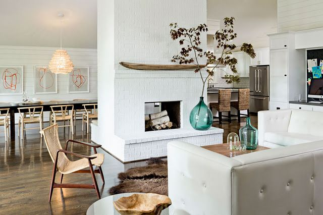LOVE a fireplace in the middle of and open layout!