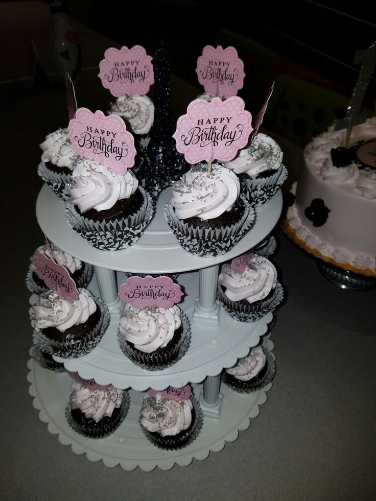 10th birthday cupcakes... ordered them plain pink pastel coolwhip...added silver sugar crystal sprinkles and diva birthday signs