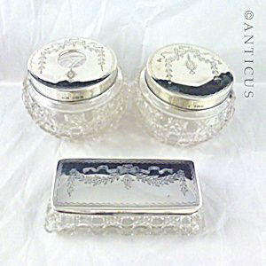 Three Silver Topped Dressing Table Jars.