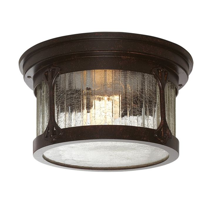 Add a touch of sophisticated style to your luminary ensemble with this hand-forged iron flush mount, showcasing a two-light design. Its crackle-glass shade adds visual appeal to your decor while its rich chestnut finish blends effortlessly into both monochromatic or vibrant spaces. Lean into this piece's versatility by adding it to an industrial-inspired living room arrangement alongside a leather-upholstered sofa and pair of wingback chairs for a complementing look. Accent the seating sp...