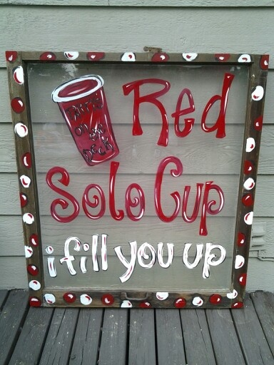 Painted red solo cup on old window
