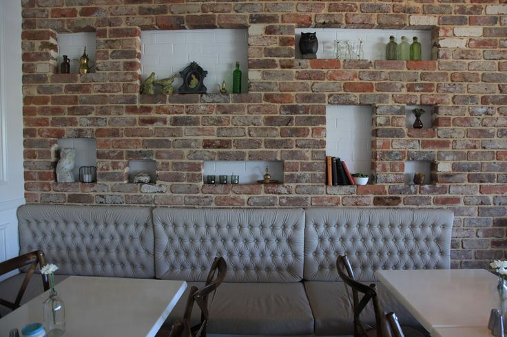 Corners on King - Banquette Seating on Recycled Brick Feature Wall