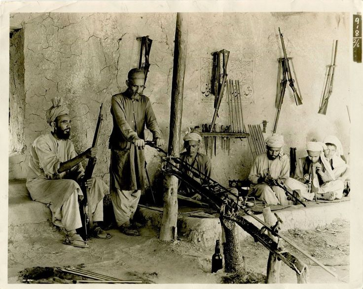 Afridi Tribesmen are Shown at Work in a Native Rifle Factory in Independent Tribal Territory in Kohat Pass India - 1935