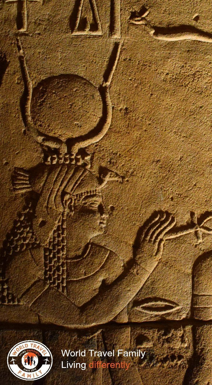 Best Places to Visit in Egypt. Isis with Ankh at Philae Temple Aswan.