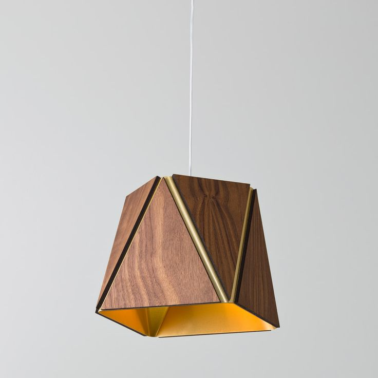 The sophisticated geometric design of the Calx LED Pendant Light combines warm wood and precious metallics. http://www.ylighting.com/blog/new-exclusive-modern-luminariesfrom-cerno/ #YinTheWild