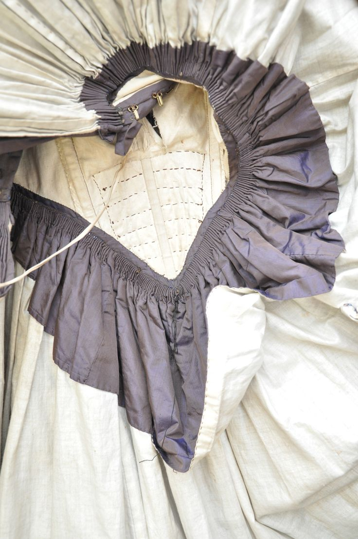 Inside-out views of an extant 1840s dress, showing lining, gauging, pockets, etc.