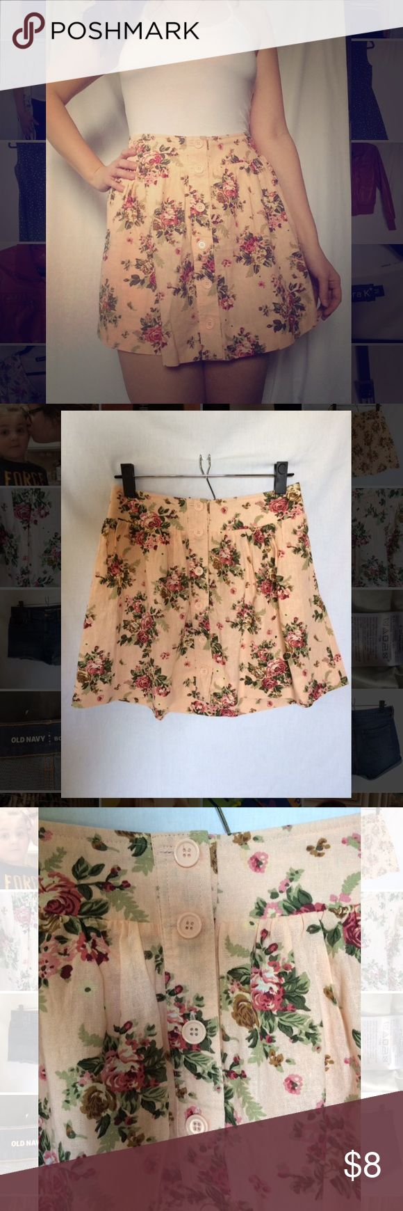 Floral Button Up Skirt Never worn. Perfect condition and super cute!  Short light pink skirt with floral design. Button detail on front. Elastic on the back of the waist band to provide stretch. Linen material.   Cute for Valentine's Day, Easter, church, dates, dinners, holiday, etc. Forever 21 Skirts Mini