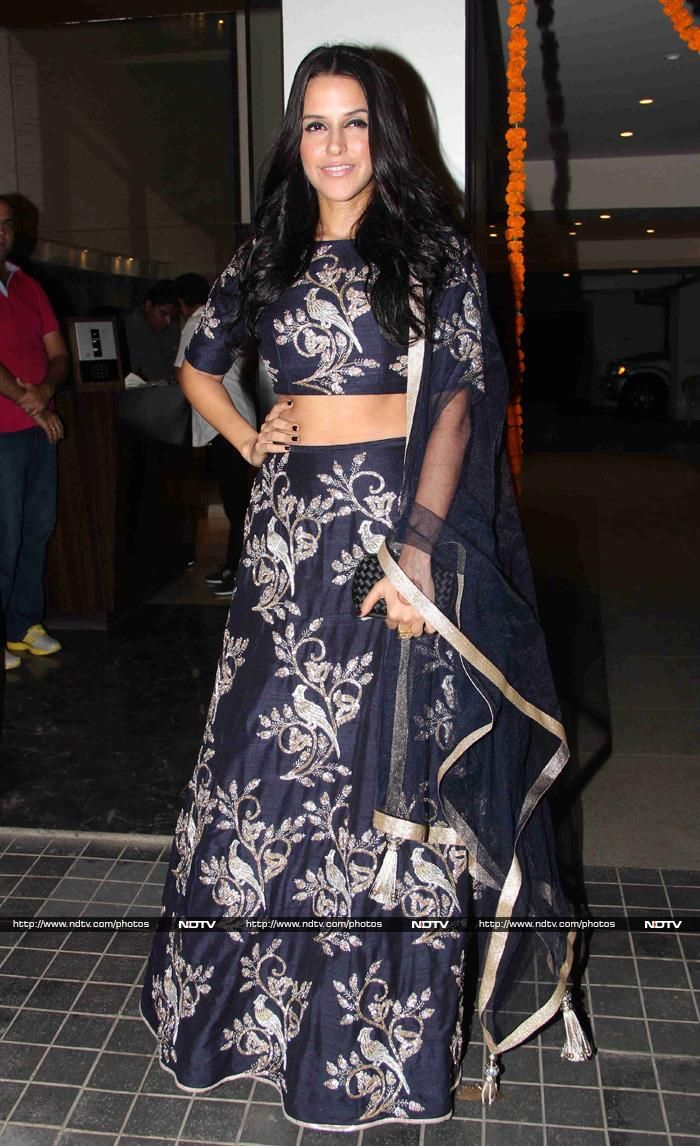 Neha Dhupia at Soha Ali Khan's Reception: Actress Neha, another good friend of the bride, picked an unusual and eye-catching outfit for the reception - a black Payal Singhal lehenga, embellished all over with silver birds and flowers. Craftily, she wore no jewellery - it worked.