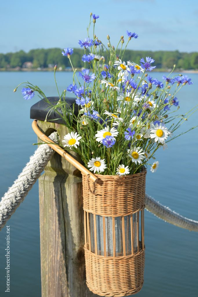 May Day Basket of wildflowers, Ox-eye Daisies and Bachelor Buttons on dock | homeiswheretheboatis.net