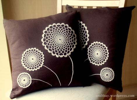 Cushions with flowers and a doily