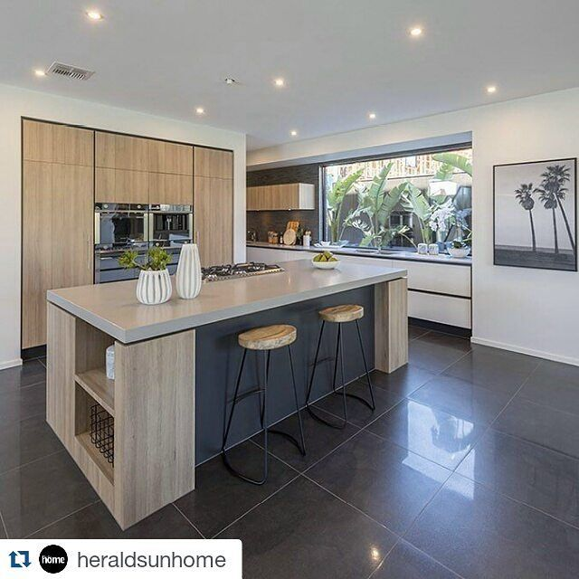 """#Repost @heraldsunhome. - """"With a large picture window to gaze out of, working in this kitchen will be a dream. A beautiful combination of natural tones with charcoal contrasts gives this chef's delight in the Zanzibar 45 by @metriconhomes its modern edge. Cleverly designed with an extra work area off to the side (leading down to the butler's pantry), this kitchen design has all the essential ingredients for modern entertaining. Check it out in Home mag this Saturday."""" #metricon…"""