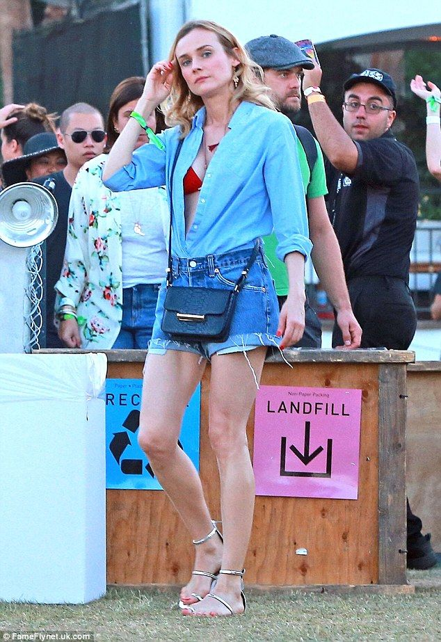 Chilling out: The beachy beauty wore a bikini top under her shirt as she hung out at the f...