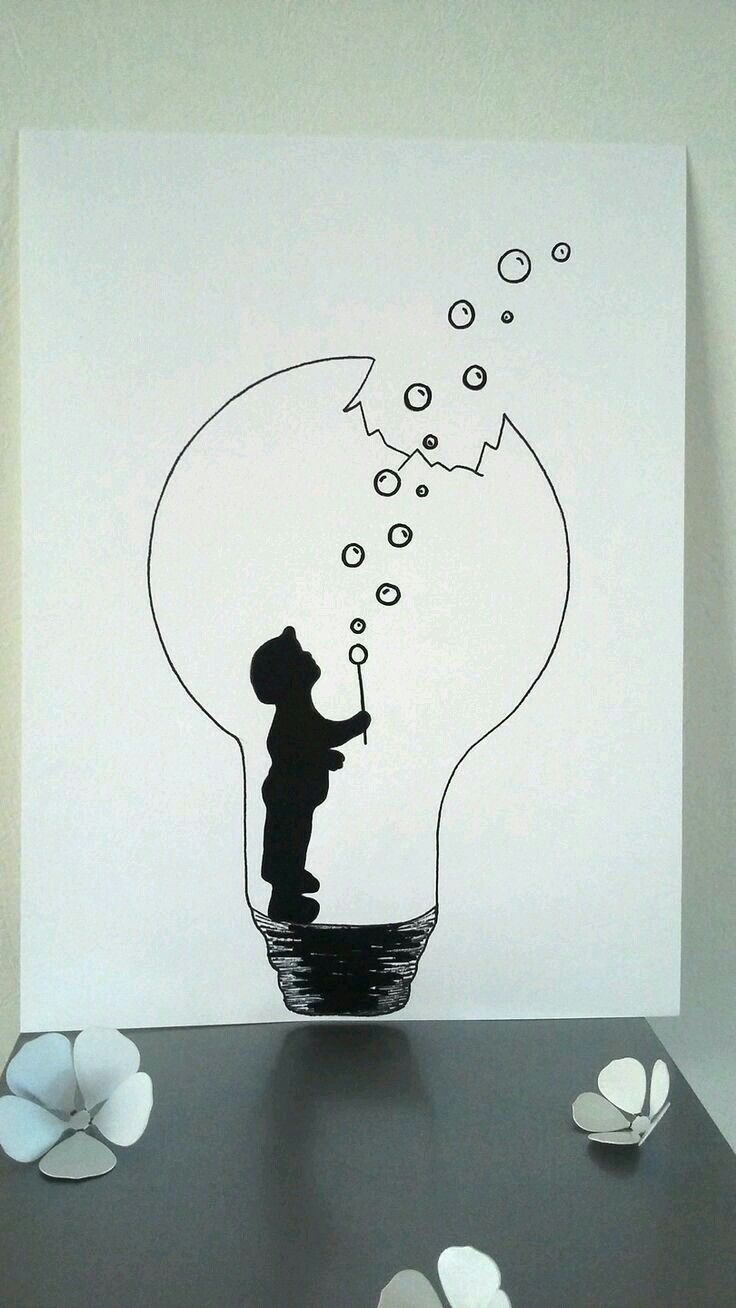A boy with bubbles in a lightbulb