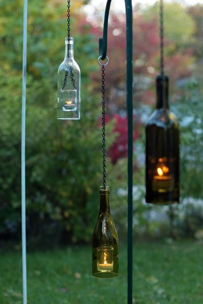 wine bottle lanterns: Wine Bottle Lanterns, Floating Candles, Bottle Lights, Candles Holders, Teas Lights, Recycled Wine Bottle, Wine Bottle Candles, Glasses Bottle, Lights Ideas