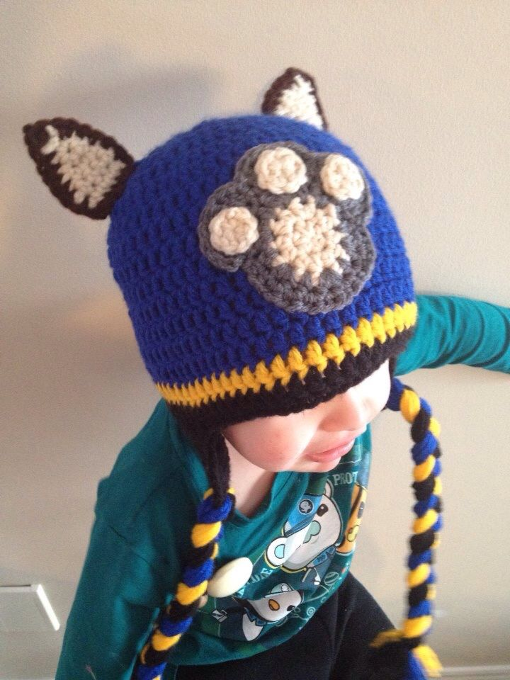 Chase Paw Patrol hat on a basic beanie using this paw print: http://www.repeatcrafterme.com/2012/08/puppy-dog-lovey-blanket-crochet-pattern.html And these ears: http://www.repeatcrafterme.com/2013/10/crochet-pig-hat-pattern.html