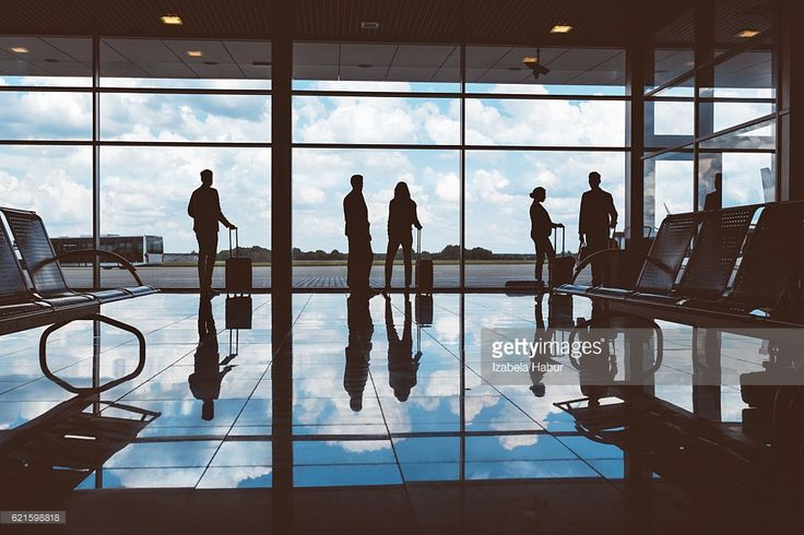 Stock Photo : People with luggage waiting at airport lounge