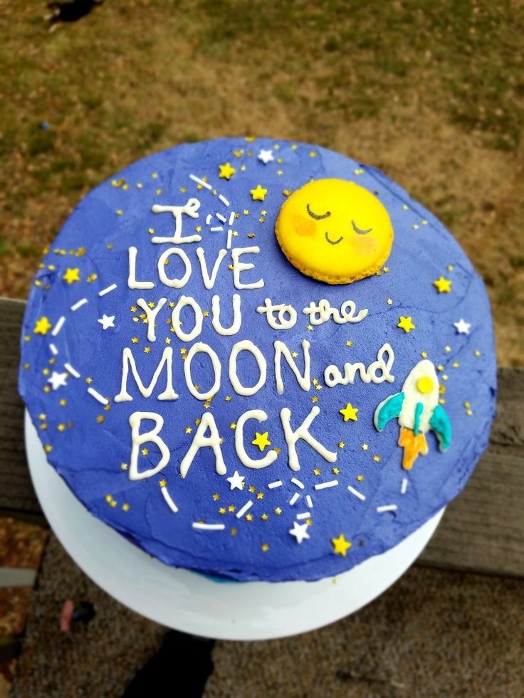 "Made this cake for a 1 year old's birthday party and am happy with the results! White chocolate letters and a hand painted macaron were the perfect details. ""I love you to the moon and back"" cake win."