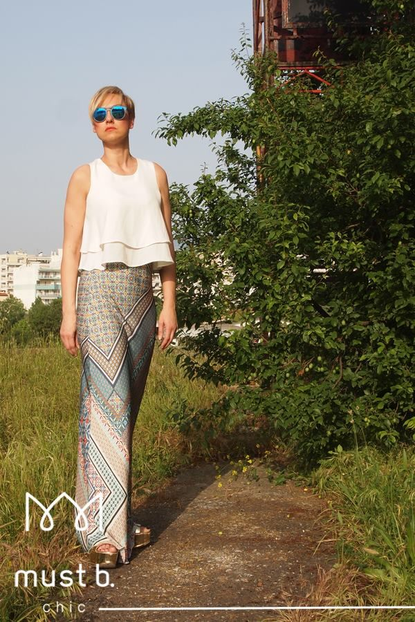Fashionable white top and color trousers. Spring Summer 2015