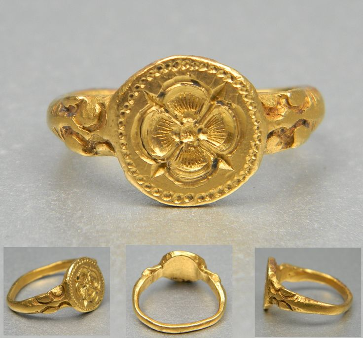 16th century gold signet ring with a rose at centre.