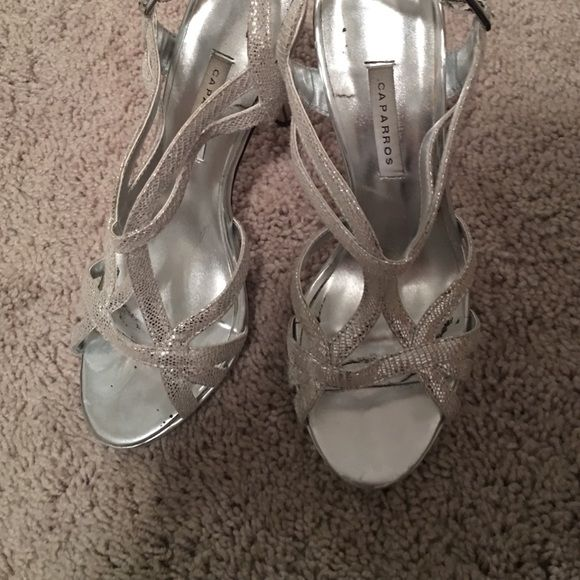 silver heels worn once to my sisters wedding. great for weddings or prom!! Caparros Shoes Heels