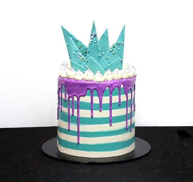 SugarBombCake- Swiss meringue stripes with matching chocolate shards and purple White choc ganache drip