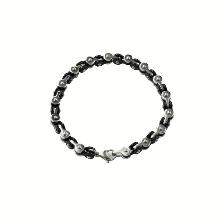 A variation on our popular bike chain bracelets, this interlocking chain alternates round black and silver links, giving it a stylish yin and yang pattern. This is our lightest weight fidget chain fidget bracelet. It has a very low profile quarter-inch width and locks with a hook and eye clasp.