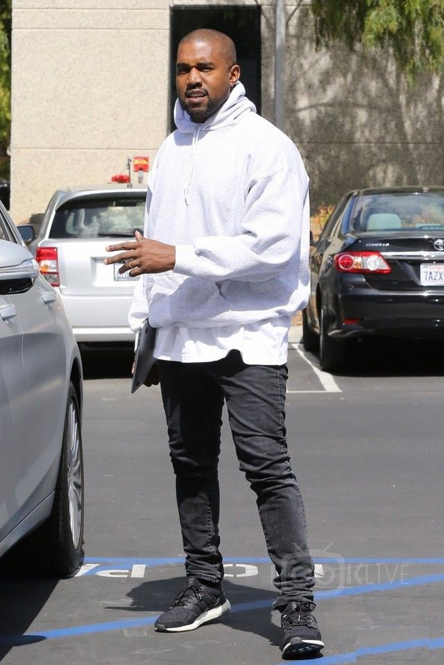 Kanye West wearing  Acne Ace Used Cash Jeans, Adidas Ultra Boost Shoes