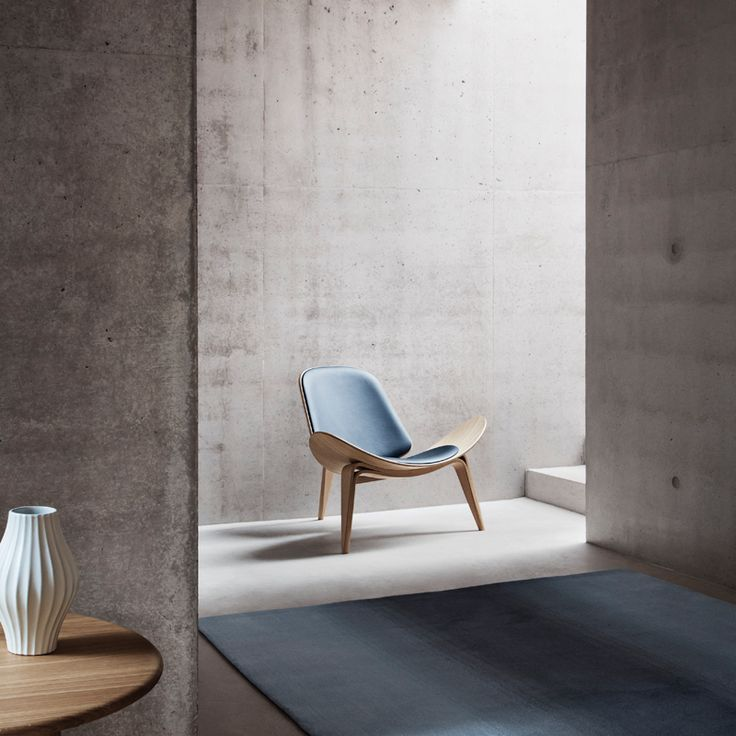 The Shell Chair CH07, a Danish design icon for the living room or lounge area, designed by Hans J. Wegner in 1963 for Carl Hansen 6 Son, and re-edited in 1998, with a huge success.   Lounge chair designed by Hans J. Wegner.