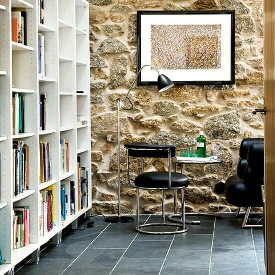 Exposed Stone Wall And Bookcase Looks Great