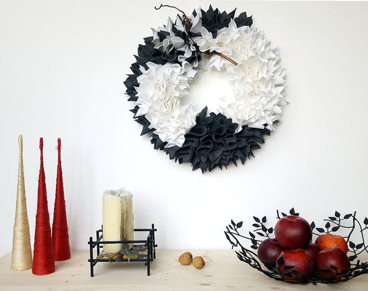 21 Modern Wreaths To Decorate Your Home With This Holiday Season // Bunches of grey and white felt give this monochrome wreath a textured look and a festive feel.
