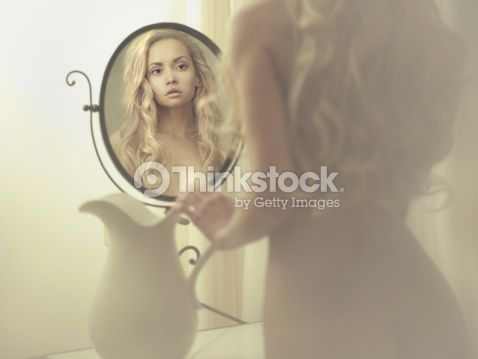 Stock Photo : Seductive woman in the mirror