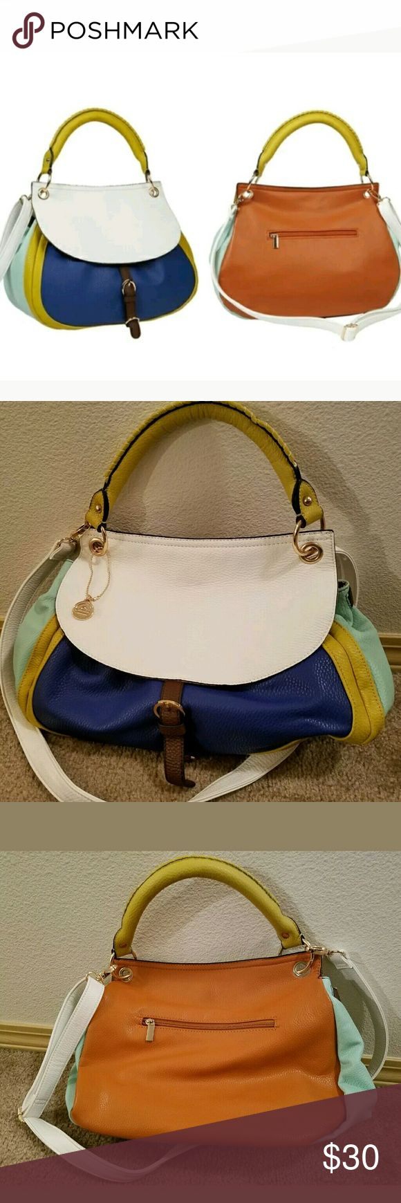 Big Buddha Color Block Crossbody Handbag This is a really great pre-owned Big Buddha Color Block Crossbody Handbag. It us in really good pre-owned condition. There are 2 scuff marks on the shoulder strap that can be seen in the last 2 pictures. If those marks weren't there it would appear that the bag had not been used. It has an adjustable shoulder strap. Show some style this spring with this beautiful spring color block bag. Big Buddha Bags Crossbody Bags