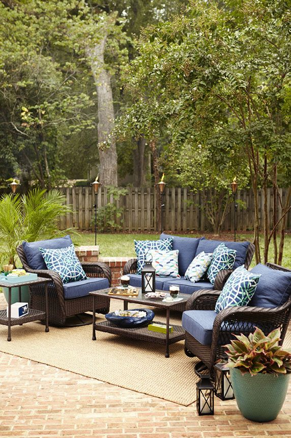 Richly Hued Cushions, A Wicker Conversation Set, And Assorted Patio  Accessories Make Your Outdoor