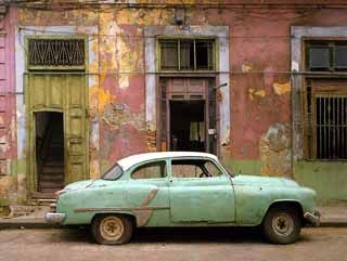Havana, Robert Polidori  car / building- rusted out but dignified