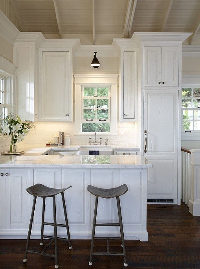 efficient white kitchen, taupe ceiling