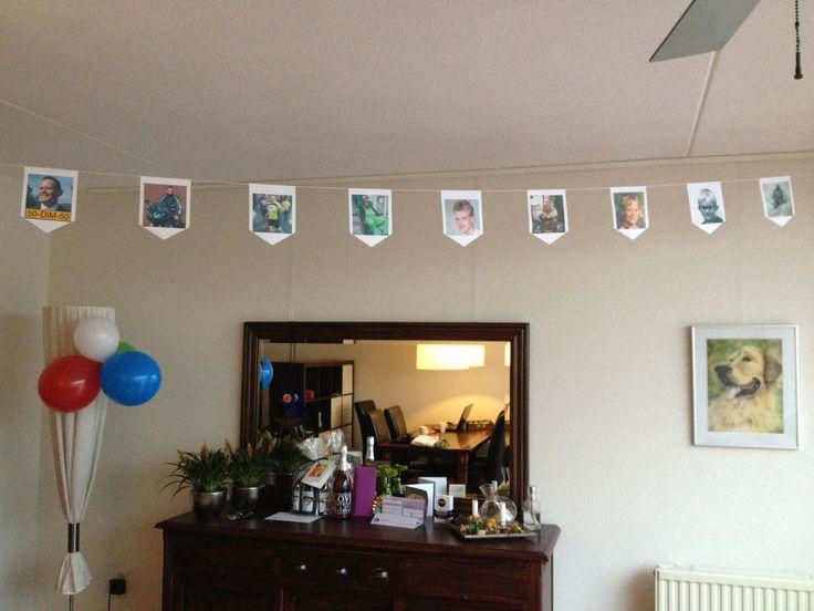 Vlaggenlijn met levensloop foto's voor de 50 jarige Dim