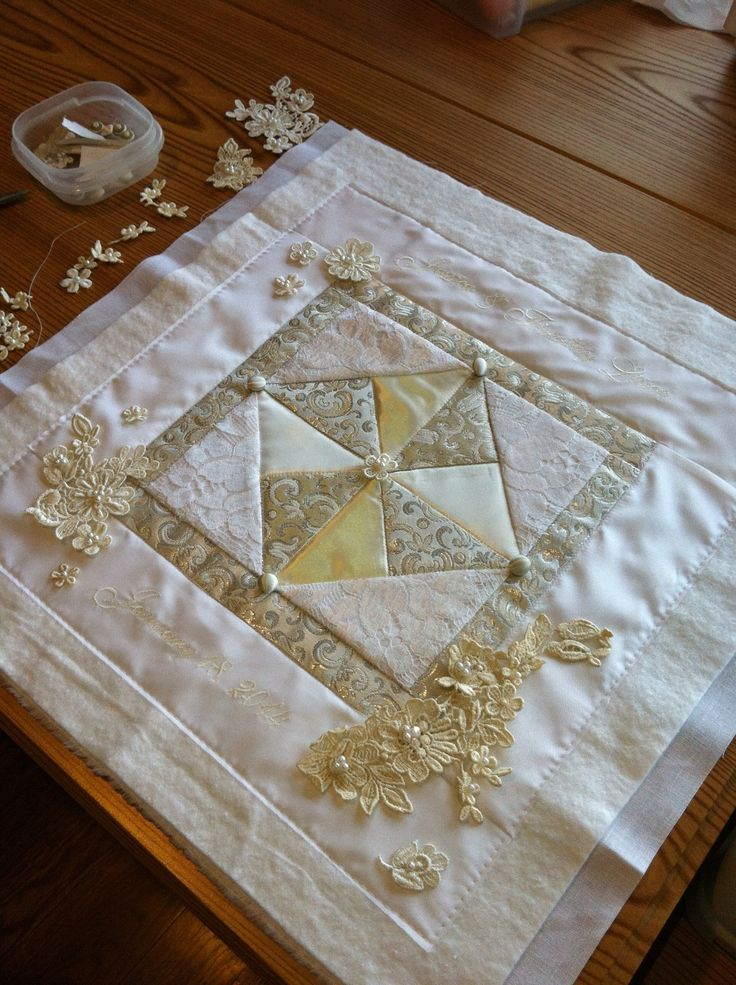 A bridal heirloom - a quilt square made from four wedding dresses; two grandmas, future mother in law and bride to be's mother.  Once completed it was placed on silk matting and a shadow box frame was constructed to protect it. Beautiful!!!