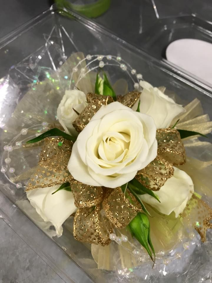 Wristlet corsage with White spray roses, gold sparkle ribbon, iridescent pearls…